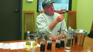 Gus sampling wine on coastal trip.